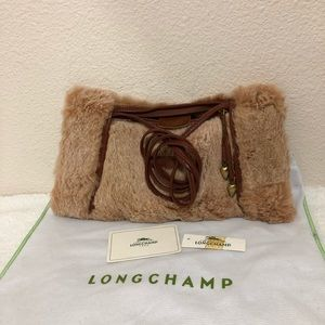 Rabbit fur muff bag by Longchamp